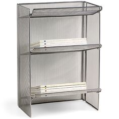The Container Store > 3-Tier Mesh Periodical Rack $40. Maybe a good option for the never ending paper tower that grows on the counter.