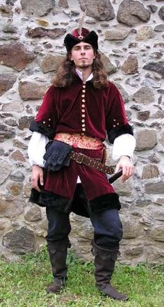 Clothing of Valachia    inspired by eastern part of Hungary, mainly by Valachian national hero Vlado Tepes.    Bordo velvet lined by black fur, hat decorated by feather, brocade sash, white shirt.    Author Ivanka.