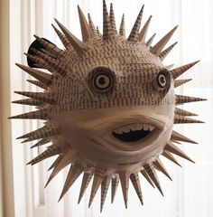 Handmade paper mache sculpture of a puffer fish.