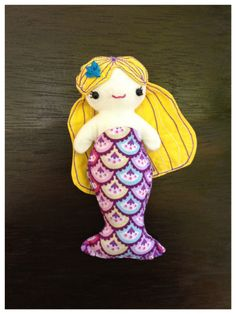 Isabella likes her hair - mermaid doll