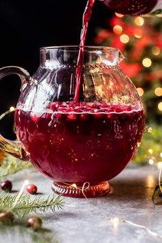 pitcher cocktails are the best secret for an easy holiday party & this poinsettia spritz punch fits the bill!  a vodka, cranberry & champagne cocktail perfect for the holidays.
