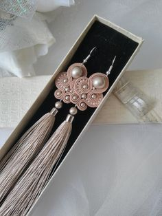 Beige Tassel Soutache Earrings Birthday Anniversary Wife gift Statement Long Soutache Earrings Large Handmade Earrings Impressive-looking, long, but at the same time light earrings that are capturing the attention of everyone. Beige Swarovski pearls, soutache cord and glass seed beads combination will not leave anyone indifferent. These earrings are perfect for your party, whether its a wedding, birthday, or maybe just an amazing day today! The back is covered with leather. The earrings…