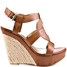 Carry out your day in the Dailona from Guess.  A soft brown leather brings forth crossing strap designs at the vamp.  An espadrille 5 inch wedge and 1 1/2 inch textured platform completes this joyful sandal.