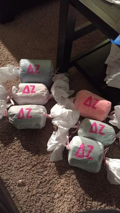 Wrap t shirts like candy!! And paint sorority name on it super cute and fun