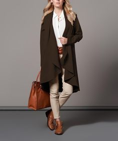 Polkadot Brown Swing Duster | zulily -  $39.99 $116.00 size: size chart S/M M/L Product Description:  An open placket and side pockets add minimalist style to this duster, while draping ruffles combine with a voluminous silhouette to showcase clean lines and a roomy fit.  Size note: This item runs in European sizing. Please refer to the size chart.      72% polyester / 25% viscose / 3% Lycra spandex     Hand wash; dry flat     Imported