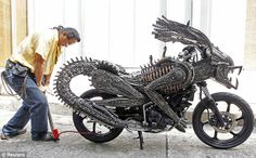 SCRAP METAL 'ALIENS' MOTORCYCLE    A man from Bangkok has used recycled materials from old cars and bicycles to create this monster-looking motorcycle. All pieces are reused and arranged in a way to resemble an alien – and we must admit, the modelling on the hands and face is extremely well done.