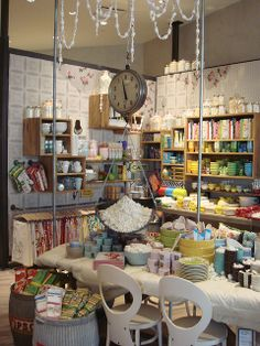 anthropologie display Linen display/ use pipe conduit/barrels .  Nice to hang vs. fold tablecloths..pillowcases.etc