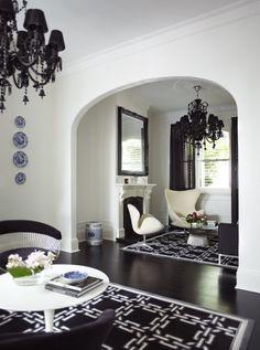Greg Natale. Black and white. Sitting room. Black chandelier.