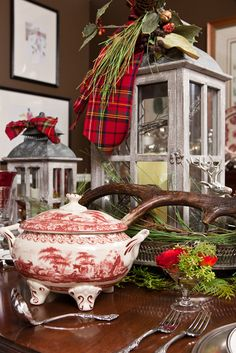 #Christmas...Love the brown paint color in this dinning room with the mix of the red transferware.