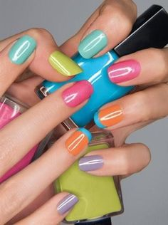 I'm in love with this trend of a different bright color on each nail. The tips on the ring finger are a good touch.