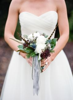 winter wedding bouquet accented with antlers and feathers