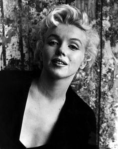 Cecil Beaton - Marilyn Monroe - February 22, 1956 - posing in a black vest or jacket