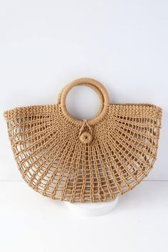 Toting around your favorite goodies has never looked chicer than with the Market Marvel Tan Woven Tote! This lightweight, woven bag is perfect for holding all of your shopping trip treasures or beach day essentials with its roomy interior and twin to Cute Handbags, Purses And Handbags, Tan Tote Bag, Tote Bags, Bag Women, Denim Overall Dress, Crochet Tote, Free Crochet, Round Bag