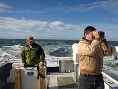 """12.16.13 - The Center for Conservation Biology is working off Virginia's shore """"surveying birds within the offshore lease area to better understand use of the area by birds. The surveys are being conducted with Tetra Tech (a global natural resource company) and the Virginia Aquarium."""" - Ned Brinkley (right) surveys seabirds while Fletcher Smith (left) records observations on a GPS-enabled tablet offshore of Virginia Beach."""