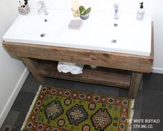 (Love rhe rug) DIY Rustic Worktable Vanity with Modern White Sinks from thewhitebuffalostylingco.com