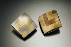 Duo of pillow pendants made with copper and brass, and copper and nickel silver. Jean Morris Designs.