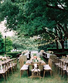 long tables and cross back chairs at Marie Gabrielle Dallas wedding reception with cafe lighting