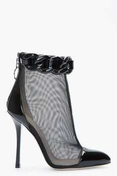 Today's So Shoe Me is the Black Mesh and Chain Trompe L'oeil Ankle Boots by Versus, $675, available at SSENSE. Cause some heavy metal mayhem in these super sexy slim stiletto ankle boots.
