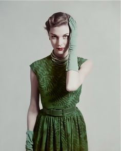 February 1948. Model is wearing a fern shadowed dress in green by Herbert Sondheim with beads around neck wearing matching green gloves.  Image by © Condé Nast Archive/Corbis.