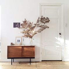 #home This darling little sideboard with oversized posie is a sweet statement