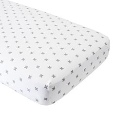 Shop Organic Iconic Grey X Crib Fitted Sheet.  Our exemplary Iconic Crib Fitted Sheet will match nearly any decor.  It features a repeating grey X pattern and is made from comfy, 100% organic cotton.