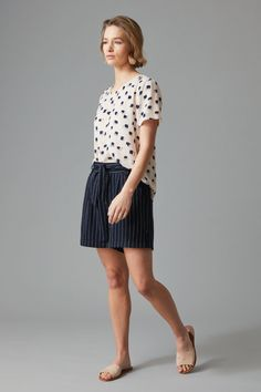 Crafted in an all natural blend of viscose and linen this tie waist short is as functional as it is stylish. Featuring front pockets, a tie waist and an elasticated back waistband for added comfort. Available in easy to wear sand and navy with a subtle nautical white stripe, these are the shorts you'll be wearing all summer long.