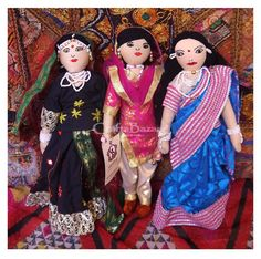 A beautifully costumed Rajasthani, Punjabi and Bengali puppet cloth dolls from India. The faces are made of plastic and the outfits are brightly colored crepe type material and intricately decorated with many different kinds of decor. #artsandcrafts #craftsofindia #indianheritage #handmade #craftsbazaar #madeinindia #artisansonline