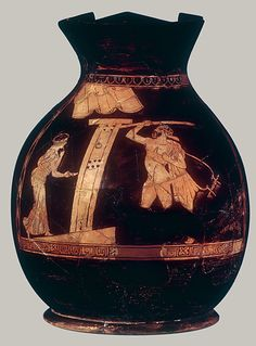 Terracotta oinochoe: chous (jug). Man with lyre and staff, woman with lamp, on opposite sides of door  The subject concerns an Athenian reveler at the end of a bibulous evening. There has been considerable debate as to whether the man is returning home or calling on a hetaira (prostitute). Of exceptional architectural interest is the abbreviated depiction of the front of a house with the solid door and the tiled roof. -