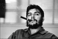 Ernesto 'Che' Guevara enjoying a cigar.