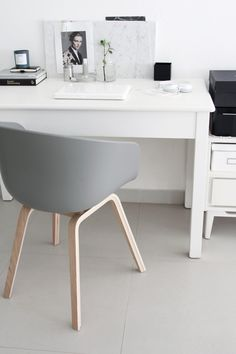 A sleek, simple, stylish work space.  The minimalist design is popular this year.