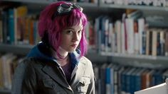 Scott Pilgrim vs. the World (2010, US/UK/Canada/Japan). Michael Cera as Scott Pilgrim is helping his girlfriend Knives Chau (Ellen Wong) pick out some calculus books at a public library. He sees the mysterious pink-haired Ramona Flowers (Mary Elizabeth Winstead) dropping off a package at the circulation desk. http://www.imdb.com/title/tt0446029/
