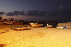 Briatico di sera by mauropaolocascasi, via Flickr | #warm #cool #orange #brown #blue #gold #boats