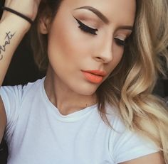 Orange lip and classic eye