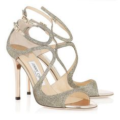 These perfect evening sandal will carry you through the season from black tie events to summer weddings. The soft bronze glitter will be elegantly understated against bright prints and glossy fuchsia toes. Heel measures 100mm/3.9