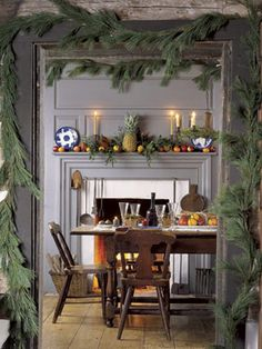 Inviting Dining Room: on the mantel sits a pineapple, an early-American symbol of hospitality. Read more: Holiday Decorating Ideas - Country Christmas Decorations - Country Living