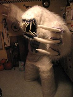 Holy crapcats! ... This costume actually made me spontaneously invent a new swear word. Anyway, nice... um... yeti? (I'm presuming this is for Halloween and not LARP due to the punkins in the background.)