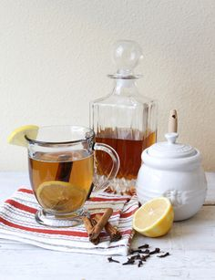 Hot Toddy. Try inserting the cloves into the lemon slice to avoid having them floating around, and adding a teaspoon of brown sugar (to taste).
