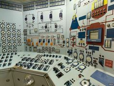 Control room covered in lights, gauges, switches and circuit illustrations | The ship that totally failed to change the world /BBC
