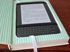 How cool is this? Using an old book for your Kindle case. LOVE.