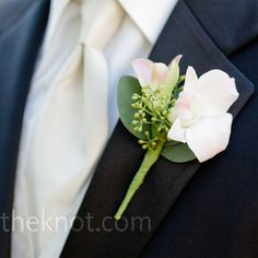 The groomsmen wore classic white rose boutonnieres.
