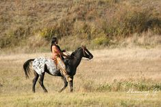 A Native American Indian on horseback on the reservation in South Dakota