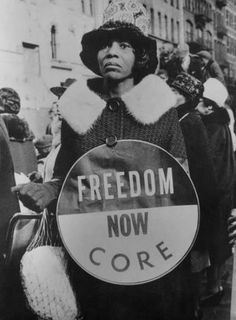 Freedom March, New York (Harlem), March 1965. I love how she is marching with what is probably dinner swinging from her hand.