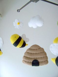 ((( INCLUDES ))) This nursery mobile contains 4 bumble bees, 1 beehive, 1 cloud, 2 daisy and 4 leaves. They are suspended from a espresso wood hanger,