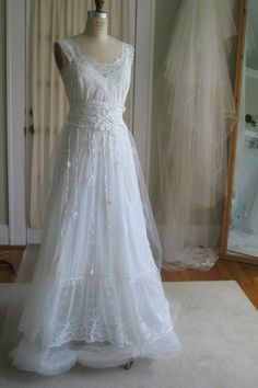 This is a one of a kind, one and only, handmade wedding dress. Upcycled vintage slip and evening dress. Off-white/light ivory. The slip has a fun,