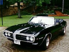 this is my dream car! 1968 pontiac Firebird convertible. few things i would have different but almost perfect. its a custom so some things are different. Badass car!!