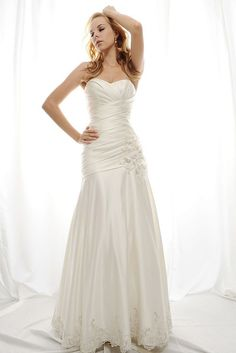 STYLE: SL010          Gorgeous strapless Royal Duchess Satin gown with a sweetheart neckline and elaborately angled draped body and low dropped waistline. The waistline and sweep train skirt hem are accented with beautifully beaded lace applique and beaded flowers. Available in white or ivory.
