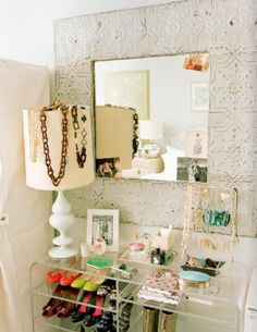 This photo make me happy. I'm loving her organized accessories and shoes, the family photos tucked into the white tin mirror, and especially the lucite shelf. My current obsession is lucite furniture and I'm hoping to find a lucite coffee table, just like Elizabeth Bauer, along my flee market journeys.   Image courtesy Lonny