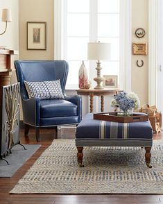 Traditional neutral living room with rich navy blue accents in linen and leather.