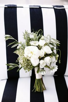 all white bouquet with bits of green