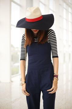 Navy blue jumpsuit with striped top from Shoulder in a casual chic outfit for summer. Also wearing Lack of Color navy hat.